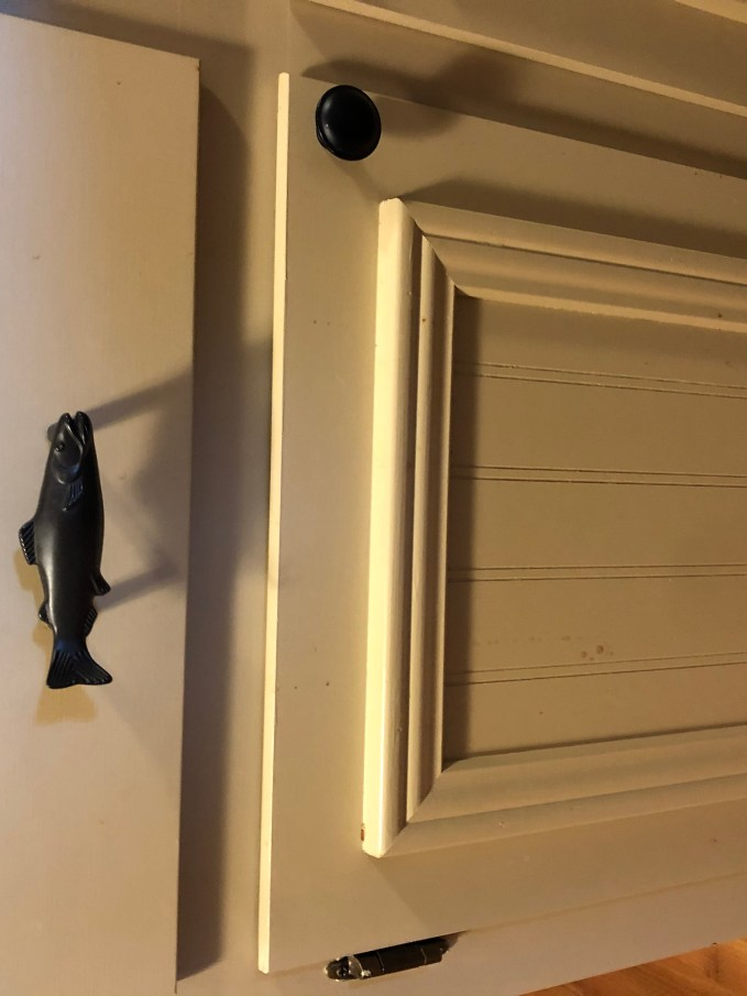 Fish drawer pulls (found online) give the kitchen a fun, whimsy feeling.