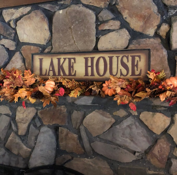 lake house fireplace mantle fall decor