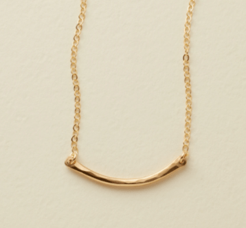 This is the Mini Hammered Crescent Bar Necklace From Made By Mary .  I chose the 16 inch length, go longer for taller girls