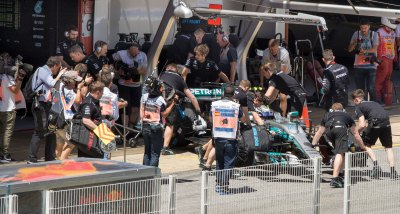 Valtteri Bottas' car is wheeled into the Mercedes garage