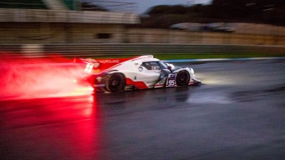 Ligier JSP3 at night in the rain