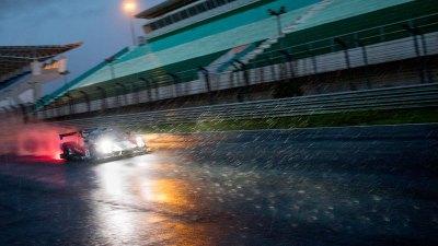 Ligier JSP3 illuminates the rain