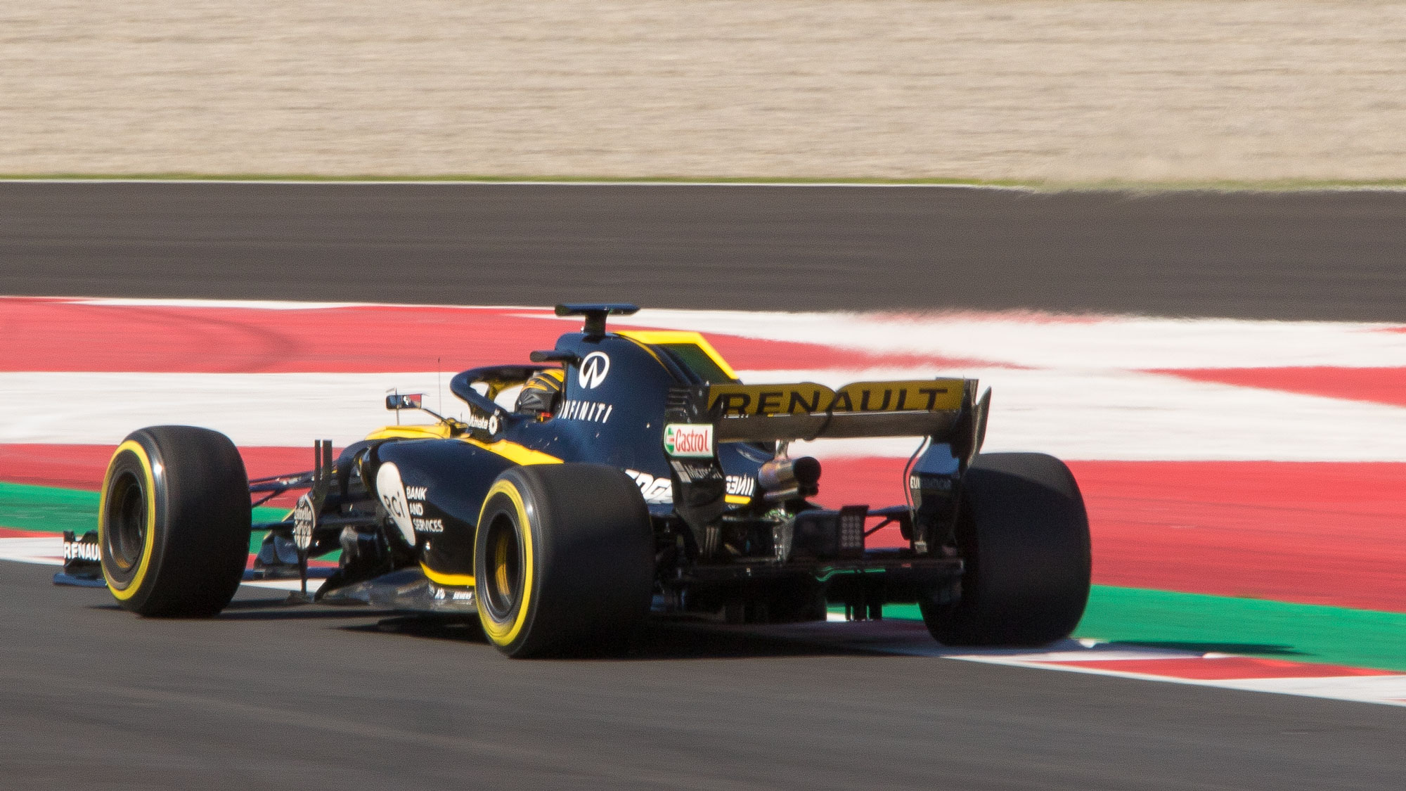 The heat haze at the rear of the 2018 Renault F1 car illustrates the effect of the exhaust blown rear wing. The gases are directed towards the wing to increase aerodynamic effect.