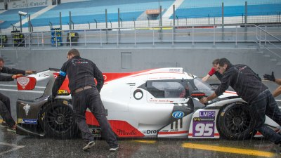 Ligier JSP3 LMP3 car pushed into the pit garage