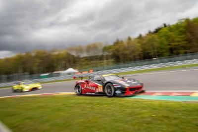 Ferrari 488 races another car into Les Combes.