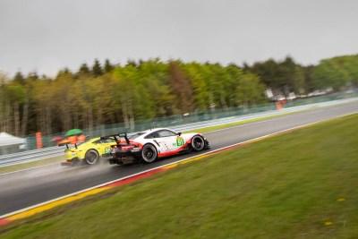 Porsche and Aston Martin Vantage go head-to-head into Les Combes.