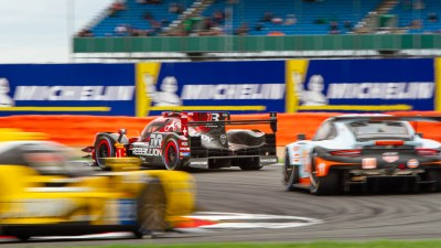Rebellion Racing LMP1 leads through Loop corner