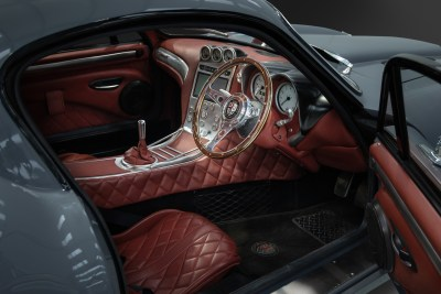 Interior cockpit view with red leather and steering wheel of a 2019 Dowsetts Classic Cars Comet