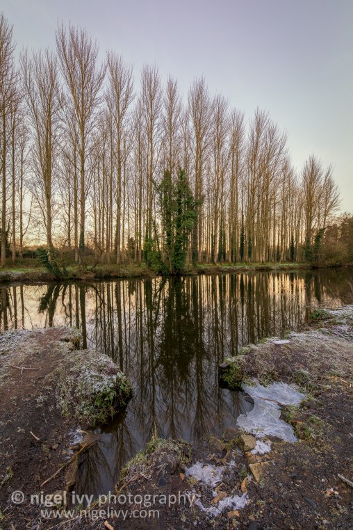 Last night was a chilly one by Belfast standards, getting to about -4 Celsius. I went for a walk along the River Lagan on the Belvoir Forest Park side and took this photo just after sunrise.