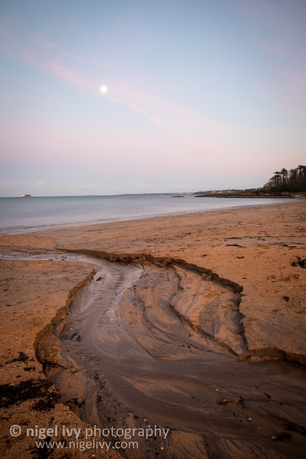 I dashed out for the sunset this evening and went to Helens Bay. The moon is pretty close to full, so looked good in the sunset colours.