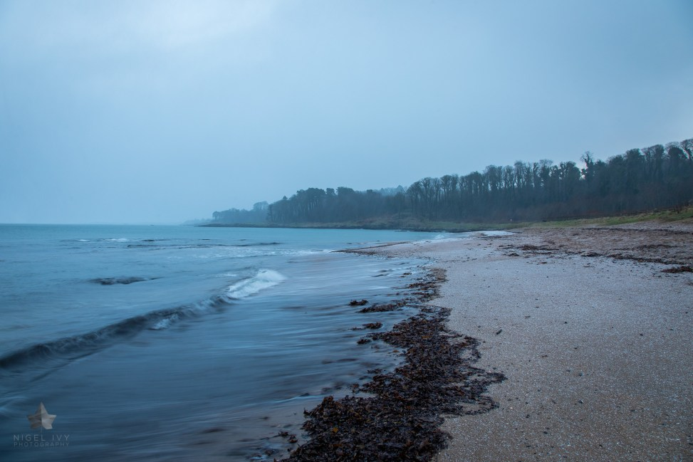 This morning I went up to Crawfordsburn beach to photograph the sunrise, but instead I got snow. Here's a new shot with the snow settling on the beach. Unfortunately, it melted pretty quickly.