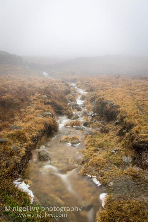 I'm just back from a very wet and very foggy weekend up in the Mourne Mountains in Co. Down. Visibility was so poor due to the fog. The normal breaktaking views of the peaks was replaced by eery whiteness. Here's a shot of one of the many streams on our way up yesterday.
