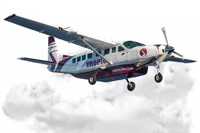 Armed men hijack plane, steal baggage