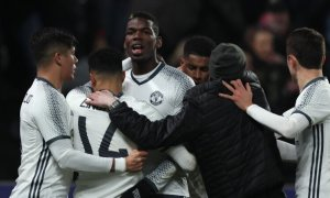 HULL, ENGLAND - JANUARY 26: Paul Pogba of Manchester United celebrates with his team-mates after scoring a goal to make the score 1-1 during the EFL Cup Semi-Final second leg match between Hull City and Manchester United at KCOM Stadium on January 26, 2017 in Hull, England. (Photo by Matthew Ashton - AMA/Getty Images)