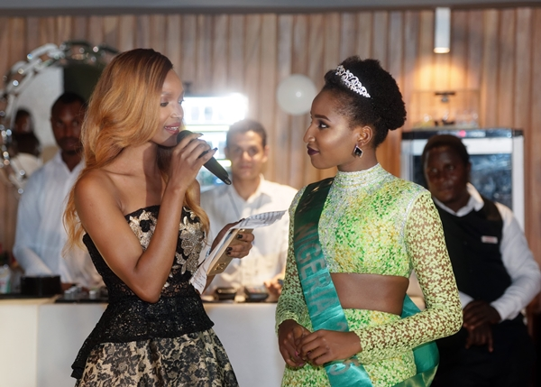 International Super Model Ex Miss Tanzania Millen Magese talks to current Miss Nigeria Lessi Peter Bigboro at LoudNProudLive NYE Luxury Edition
