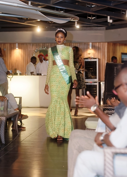 Miss Nigeria in official costume dressed by Frank Osodi by Bunor does a walk of honour before the runway show commences at LoudNProudLive Luxury Edition
