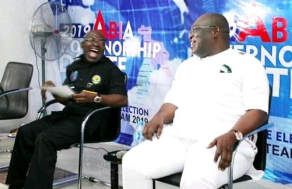 Dr. Alex Otti and Gov. Okezie Ikpeazu sharing pleasantries at 2019 Abia Governorship Debate
