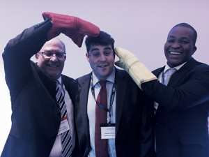 "L to R Ettore Poggi - VP Africa and Director Maintenance, ExecuJet, Al Whyte - Corporate Jet Investor Editor, and Segun Demuren - CEO of EAN Aviation, proudly sport their oven glove prize, intended to help them handle business in the ""hottest"" market."