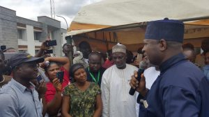 Minister of Aviation, Hadi Sirika addressing demonstrating Aero Contractors workers