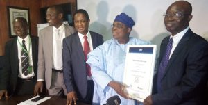 Managing Director, Medview Airline Alhaji Muneer Bankole receiving the IOSA Certification from Sampson Fatokun, IATA Regional Director West Africa