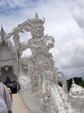 Demon guard at the entrance to Wat Rong Khun