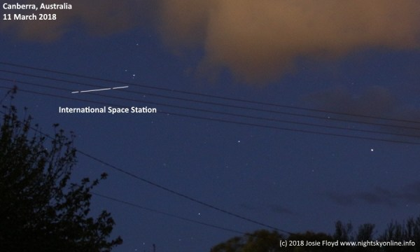 Look up International Space Station visible in night sky