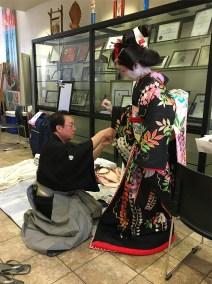 "Bando Toshitaro prepares dancer Bando Hidesomi for her performance in the classic dance, ""Fujimusume."""