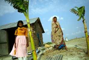 A family at their house at a char in Sariakandi