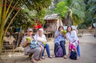 Enjoying coconut on a tribal village