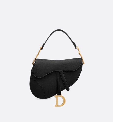 the picture shows the new dior saddle bag in black leather