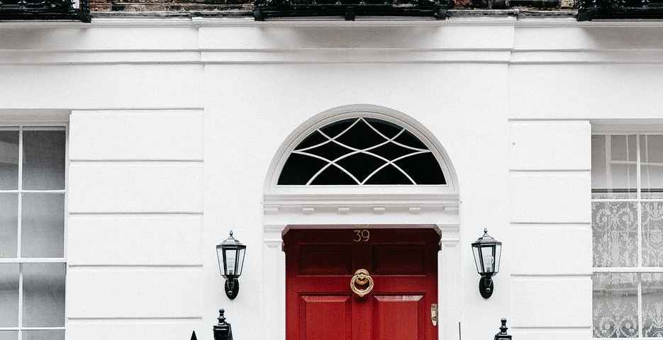 facade of residential building with red door