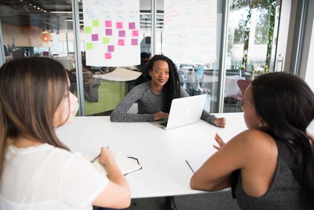 three woman having a meeting