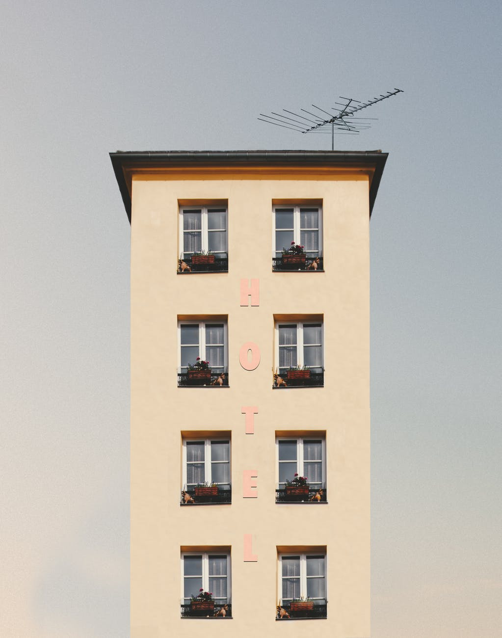 low angle photography of beige concrete building
