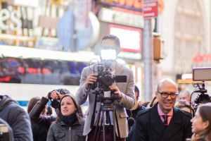 journalists standing behind barrier