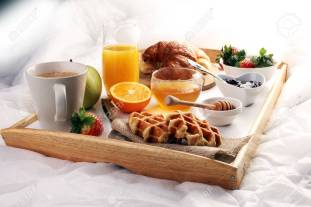 83426697-breakfast-in-bed-with-fruits-and-pastries-on-a-tray.jpg