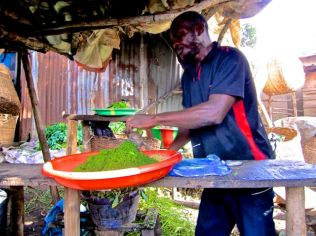 Grinding cassava leaves