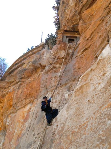 A priest doing the same