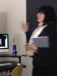 Irene Mata passionately discussing Chicana art.
