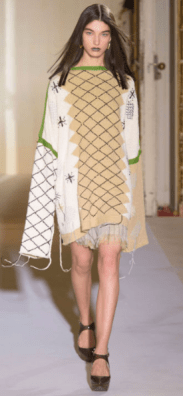 ACNE STUDIOS Contrasting patchworks create a bohemian style of voluminous sleeves and free-spirit design.