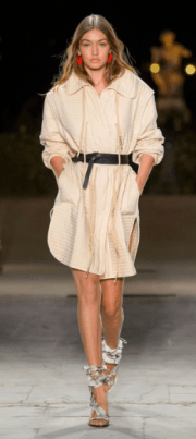 ISABEL MARANT The oversized neutral tunic tightened at the waist with a chunky belt is casual yet chic with a touch of bohemian style.