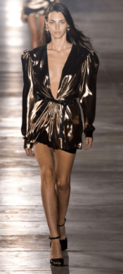 SAINT LAURENT The gold and black minis with strong shoulders and a sense of excess were displayed in the Saint Laurent show bringing back the love of the 80s.