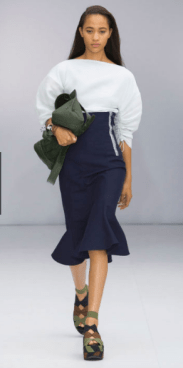 SALVATORE FERRAGAMO The two-toned design remains subtle featuring a puffy white top with drawstring sleeves and a navy midline peplum skirt.