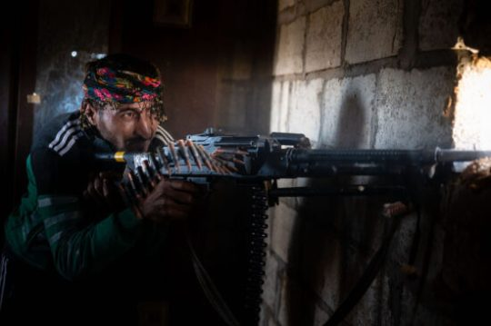 Syrian civil war: A Kurdish-Arab fighter fires his machinegun on Turkish backed militants in late 2019 / Z6, 50mm, f2.8, ISO 2000