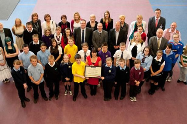 Pupils, teachers, elected members and Community Activists celebrate their success.