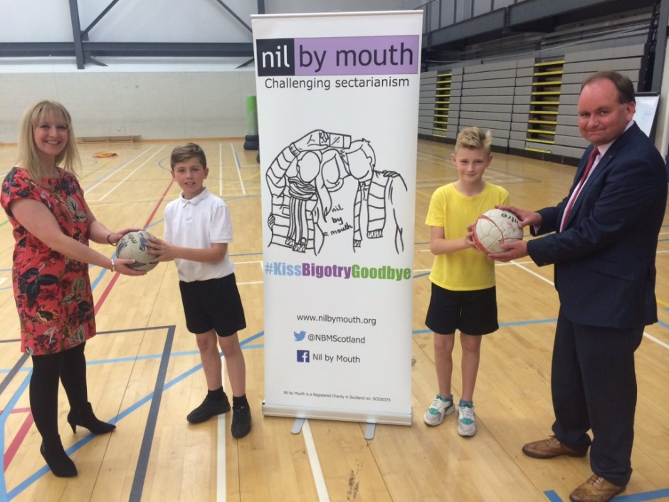 Debbie and John from Agripa present footballs to Cameron and Calum representing the schools