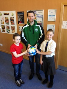 Pupils hand over Fairtrade balls to Africa on the Ball Trustee Andrew Jenkin