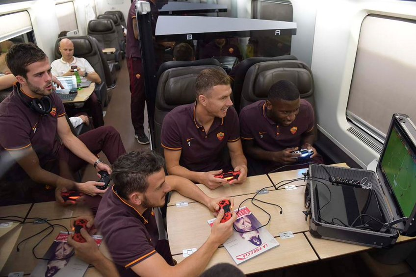 AS Roma Players relaxing in the bus