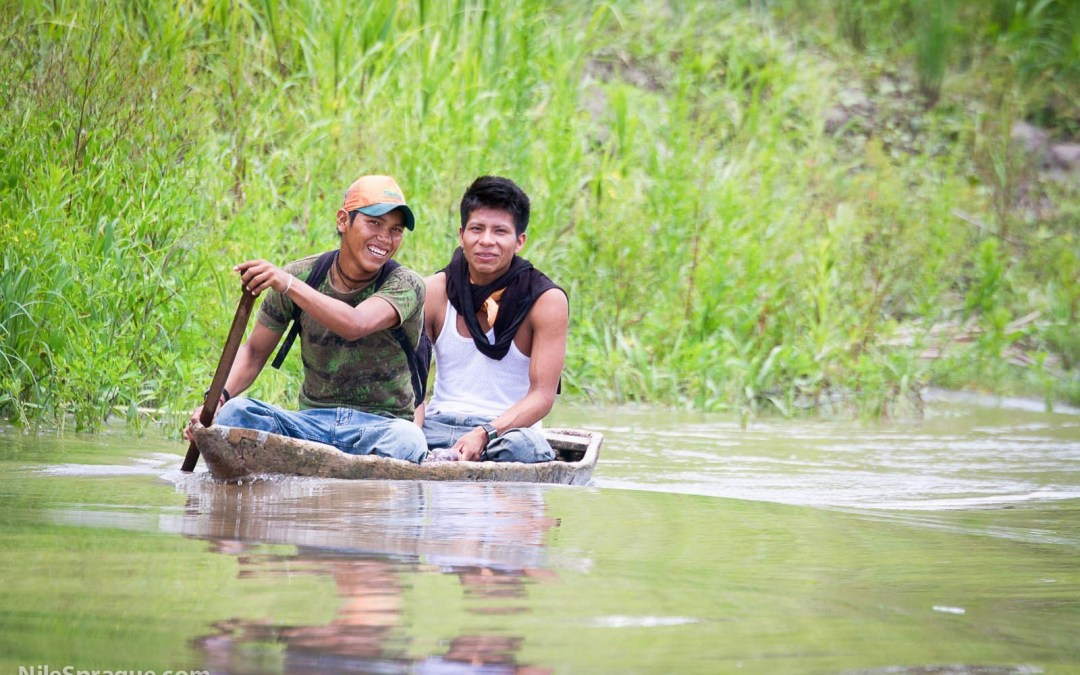 Photo: Men in Dugout Canoe on Amazon River, near Iquitos, Peru