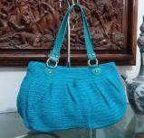 tas dengan handle berbahan kulit