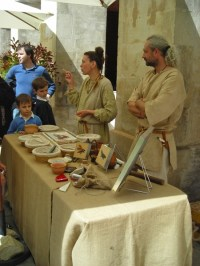 Mosaic makers in Roman costumes.